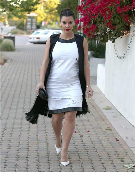 Kim K paired a long fringe vest with a white frock for sister Kourtney Kardashian's birthday dinner at Taverna Tony in Malibu, Calif., on April 18, 2013