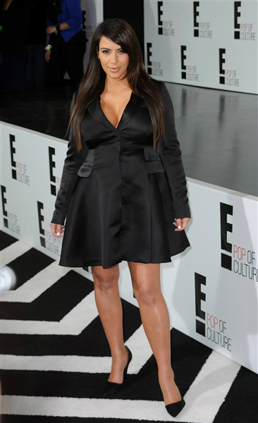 The expectant mom wore a menswear-inspired mini-dress that accentuated her ample bosom at E!'s upfront presentation in New York City on April 22, 2013