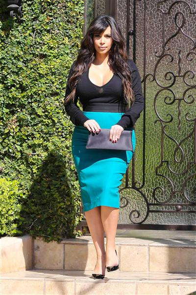 The usually achromatic starlet sported a rare pop of bright color, a loud turquoise pencil skirt, which she paired with a seethrough black top, when she left her Beverly Hills home on March 24, 2013
