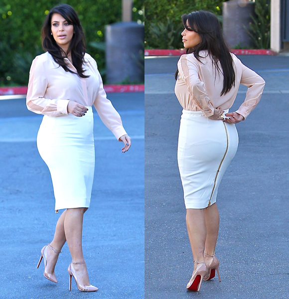 Warning Dangerous curves ahead The momtobe showed off her bumps in the front and back in a tight white pencil skirt, which she paired with a blush buttonup while filming her realityTV show in Los Angeles on March 12, 2013.