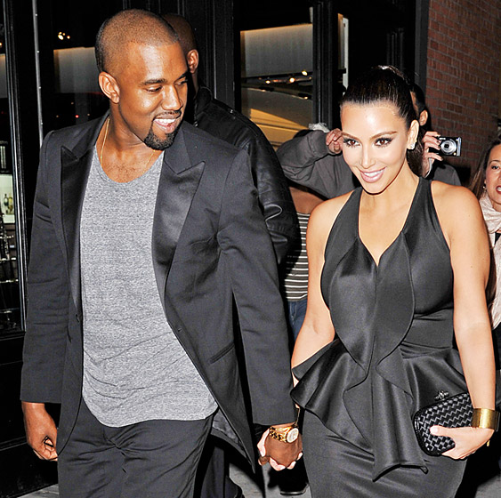 Kim & West held hands on their way to the April opening of Scott Disick's new restaurant in NYC