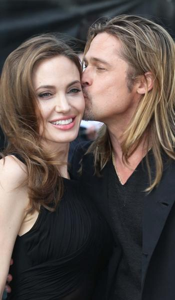 Jolie gets a kiss from Pitt.