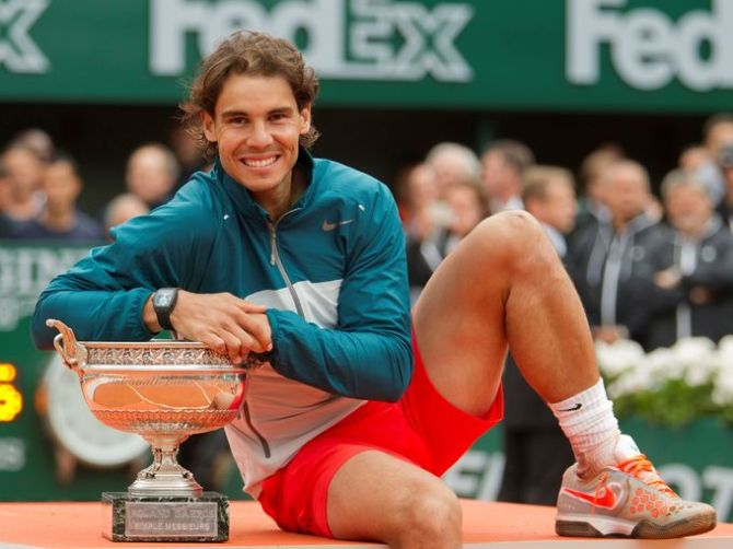 Rafael Nadal poses with his trophy